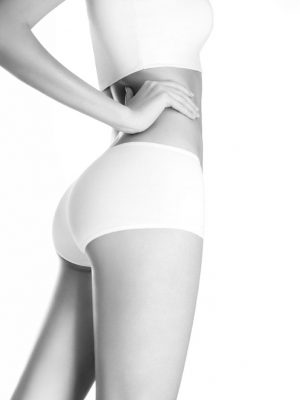 Profile view of beautiful woman  body  dressed in white underwear